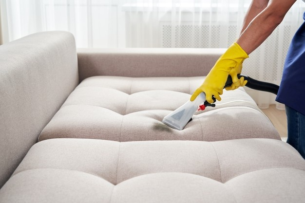 close-up-housekeeper-holding-modern-washing-vacuum-cleaner-cleaning-dirty-sofa-with-professionally-detergent-professional-springclean-home-concept_130111-3654.jpg