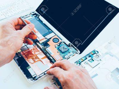 121260644-laptop-repair-service-pc-hardware-upgrade-and-maintenance-engineer-fixing-broken-notebook-computer-t.jpg