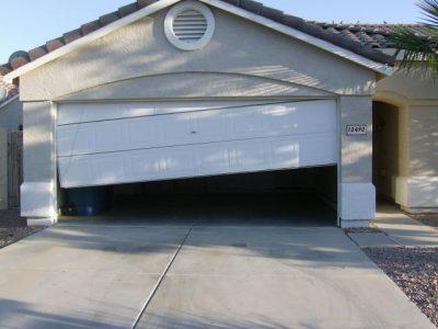 greensboro-garage-door-fallen-off-tracks_orig.jpg