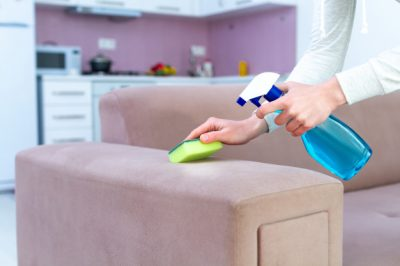 cleaning-couch-with-sponge-spray-room-home-housekeeping-cleaning-service-washing-furniture_122732-1353.jpg
