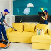 young-man-with-vacuum-cleaner-washing-with-vapor-yellow-sofa-beautiful-woman-wipes-cuisine-furniture_141188-2567.jpg