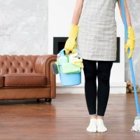 female-janitor-standing-home-holding-cleaning-products-mop-hand_23-2148222243.jpg