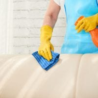 mid-section-unrecognizable-housekeeper-wiping-leather-sofa-with-leather-polish-spray_1098-19042.jpg